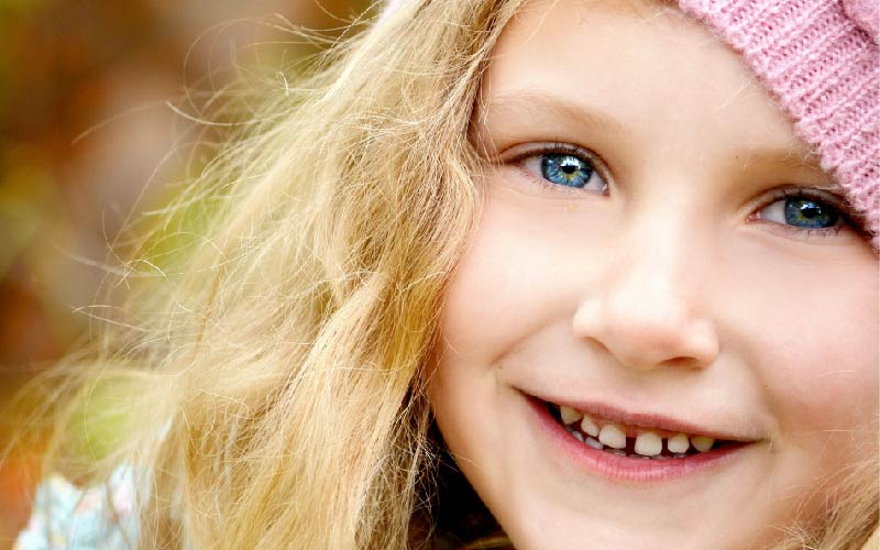 young child with toothy smile