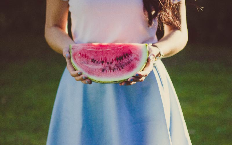 girl holding watermelon